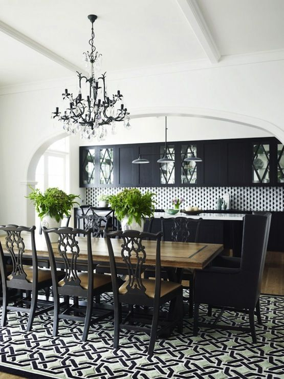 Greg Natale: Chic black and white open plan dining room with black crystal chandelier over black ...
