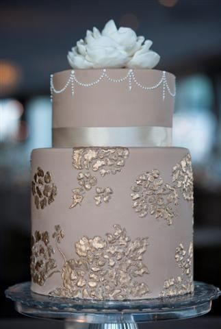 Taupe cake with silver floral detail and a beautiful light blue peony topper.  Beautiful!  ᘡղbᘠ