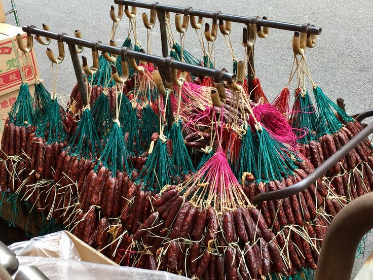 Bill ✔️ Here are the wares of a Chinese Sausage (Salami) maker as he prepares to trundle them through the Market streets, stocking up his various retailers. Sheung Wan, Hong Kong Island, Hong Kong , China.      Bill Gibson-Patmore.  (iPhone image, curation & caption: @BillGP). Bill ✔️.