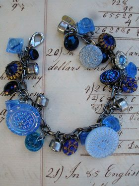 Vintage Blue Button Repurposed Bracelet Number 2  his bracelet has all vintage buttons in shades of blue! There are so many different varieties and sizes, some with blue rhinestones, some with gold accents, all glass or metal, all with various signs of age (which we love!)!...