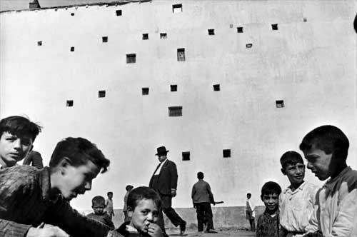 Henri Cartier Bresson.  The Father of Modern Photojournalism.  http://en.wikipedia.org/wiki/Henri_Cartier-Bresson