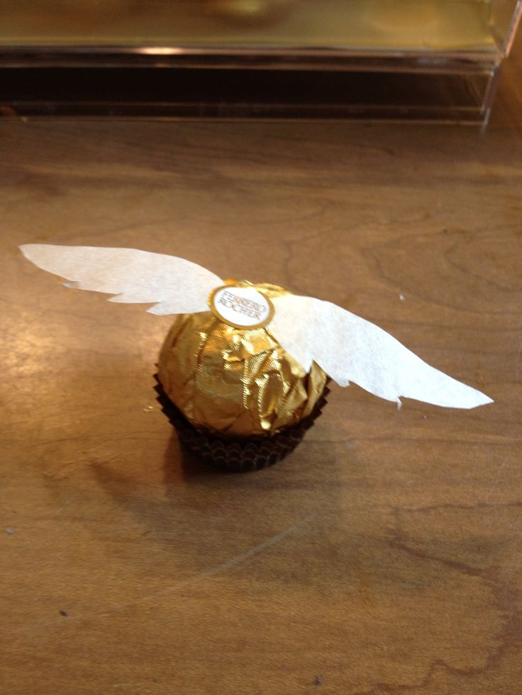 Golden snitch - made from Ferrero Rocher chocolates and tracing paper.
