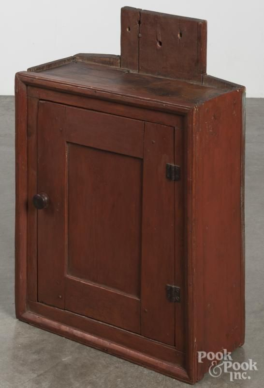 Stained pine hanging cupboard, 19th c., retaining an old red stain, 30'' h., 19 1/2'' w. - Price Estimate: $300 - $500