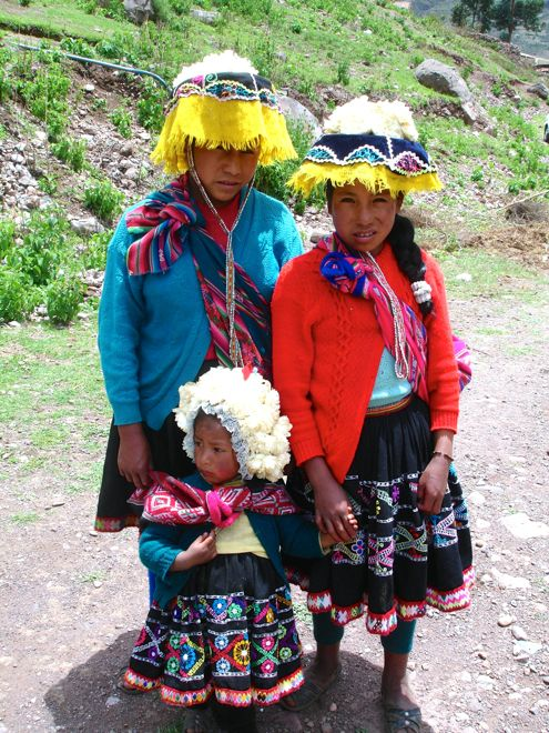 Meeting the local kids in Peru. #travel #kids #travelwithkids #familytravel #familyvacations #familyholidays #peru http://www.suitcasesandstrollers.com/articles/view/the-sacred-valley?l=all