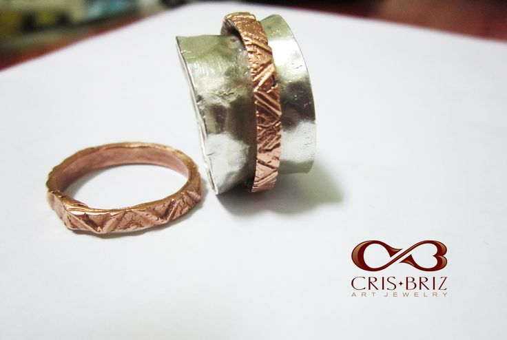 Spinner ring and thumb ring by Cris Briz