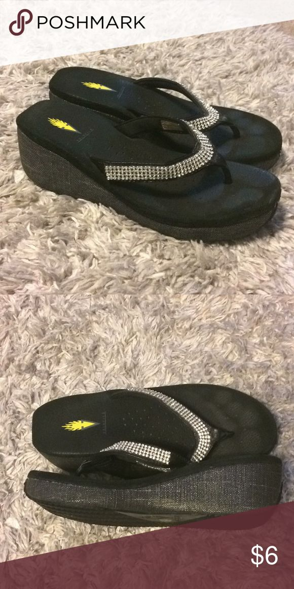 Volatile sparkly flip flops Volatile wedges. These show some wear, but have loads of life left. Very comfortable with a splash of bling! Volatile Shoes Sandals