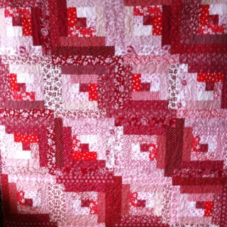 Log cabin quilt in red and white. I finished it Dec. 2011