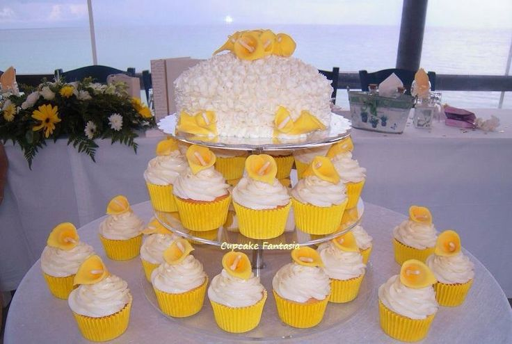 Cupcakes with special decor top tier cake