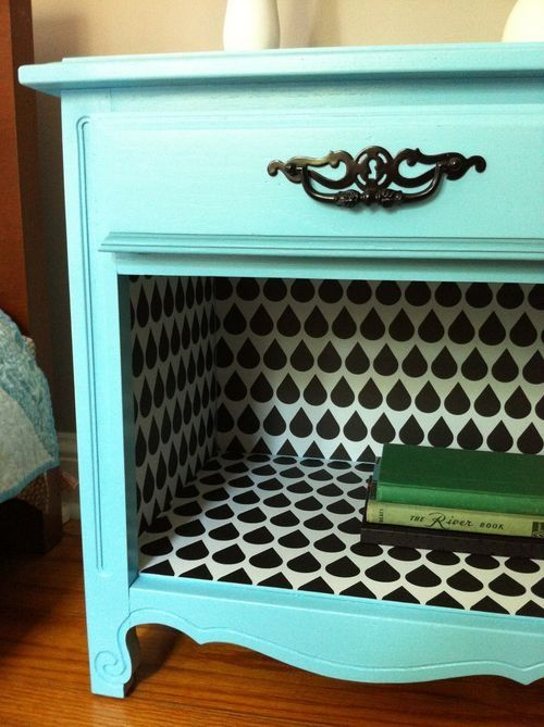 Thrift Store bedside table update. Take off the bottom door, paint a fun color, and wallpaper the inside.