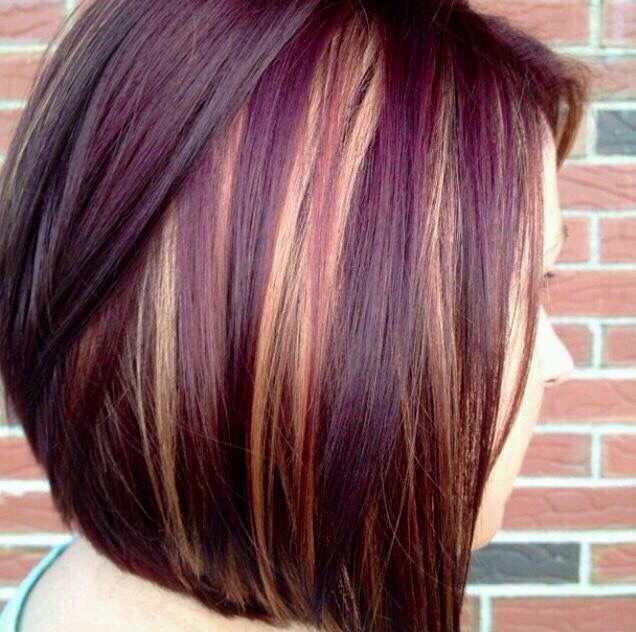 Cute short hair cut with purple and blonde highlights.