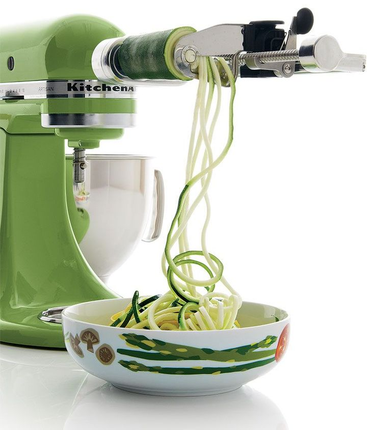Green Kitchenaid Artisan Mixer with a spiralizer attachment, making zucchini noodles.