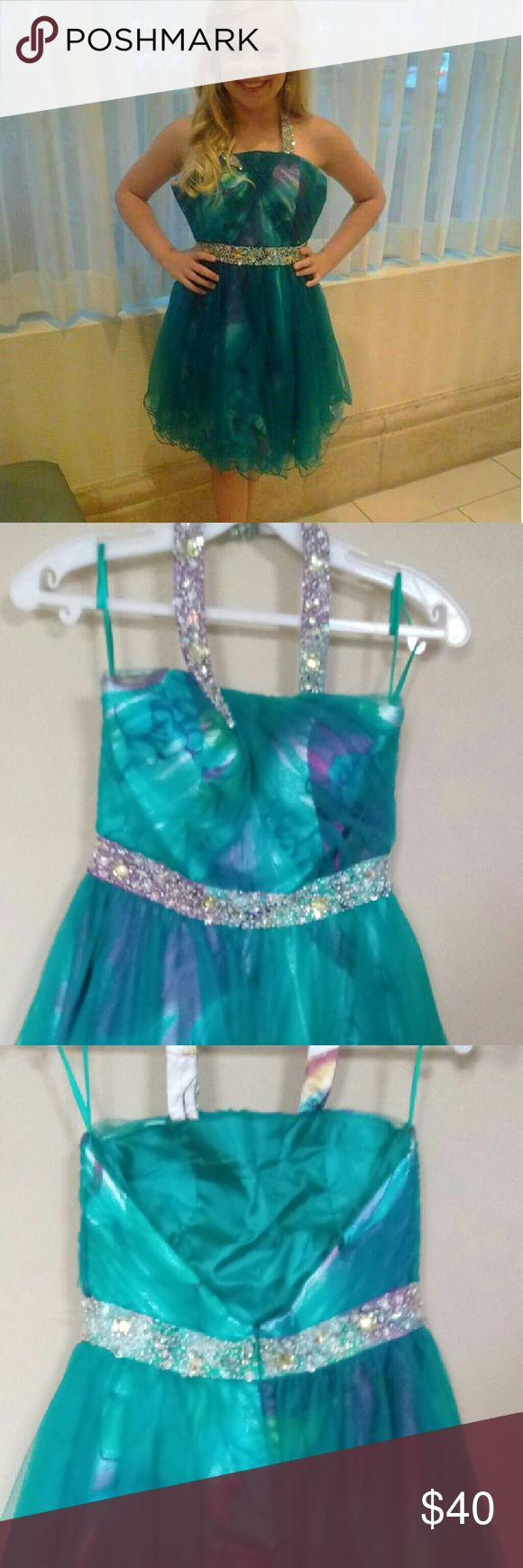 Teal homecoming dress Adorable cocktail dress. Teal with silver rhinestone accents.  Size xs .  fits size 0/2 Dresses Mini