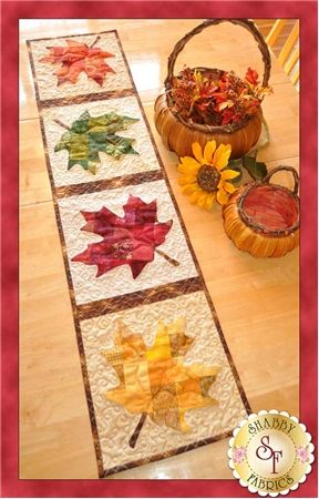 Patchwork Maple Leaf Table Runner Pattern: Say hello to the winds of autumn with this stunning runner. Designed by Jennifer Bosworth of Shabby Fabrics, this design features patchwork - a great way to use up scraps! - and applique. Pattern includes all instructions for the 12 1/2