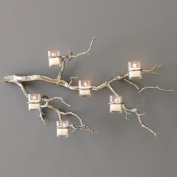 find a branch, chrome spray paint, and hang... hmmmm? I must try this