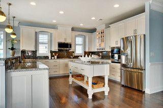 Luna pearl granite counters, dark hardwood floors, white cabinets with crown moulding, brushed nickel hardware, blue walls