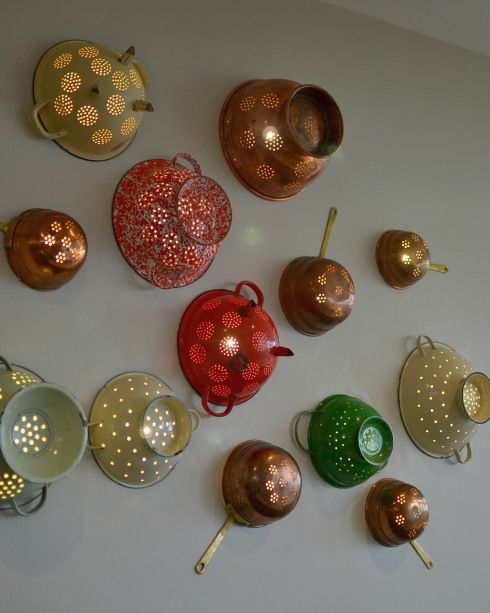 Upcycled colander wall lights - great idea for a blank kitchen wall! Kitchen lighting.