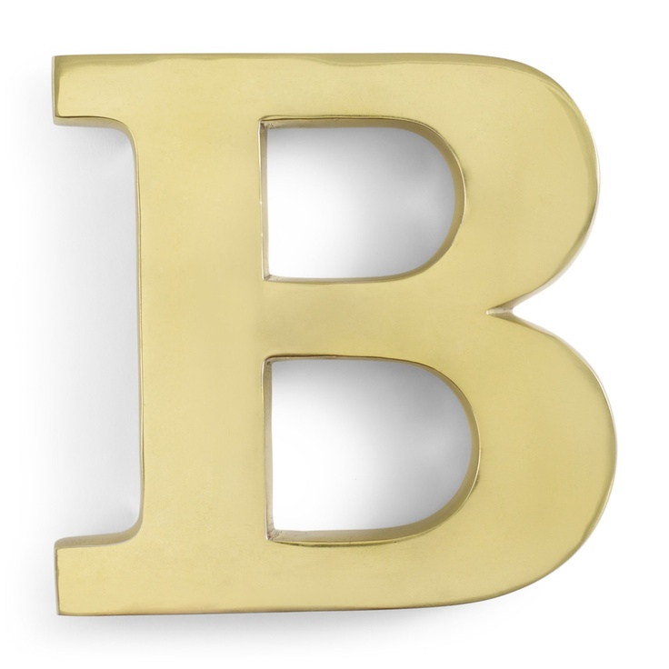 C. Wonder gold 'B' monogram letter. Her home is TBD...with mantle display? console?