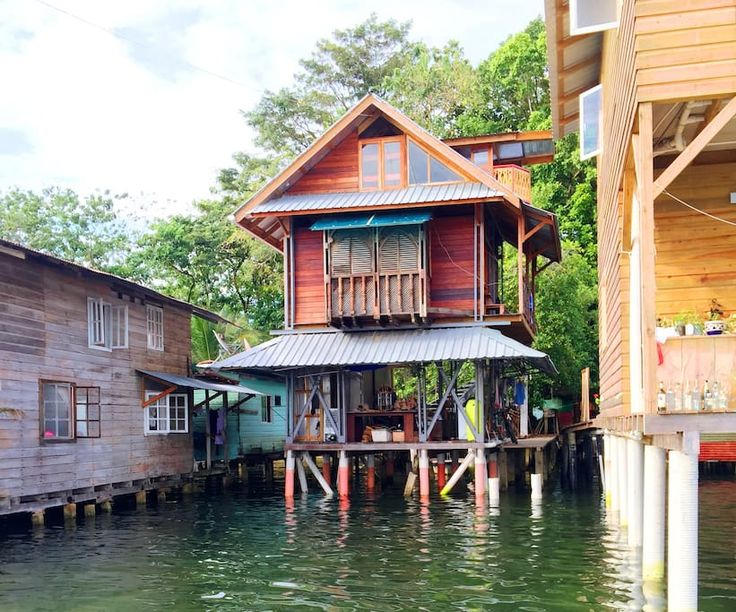 House in Bocas del Toro Isla Colon, Panama. Designed and built by an artist, this wooden three bedroom house is on stilts on a beautiful bit of calm sea on the edge of the main town. You can swim in the sea around the house or by the beach on the other side of the road just 50 meters away. ...
