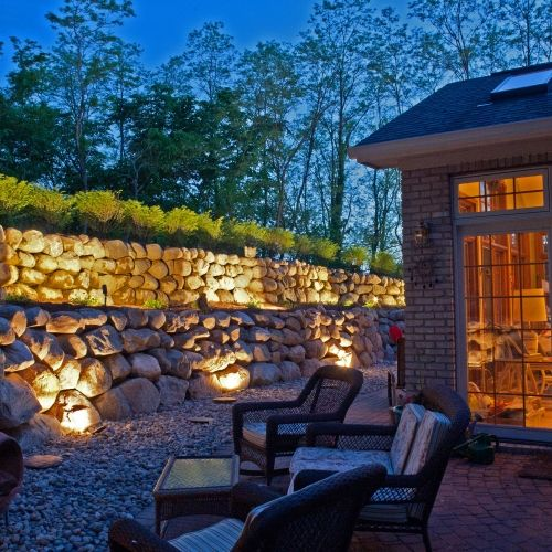 Elegant boulder wall securing a hillside in Michigan constructed by Todd's Services Landscaping Company.
