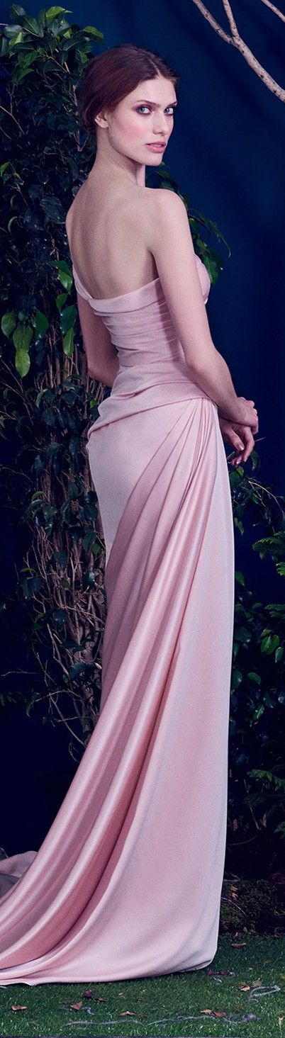 Drape: Beautiful draping from center hip elongated to center back and then released as fullness into the skirt.