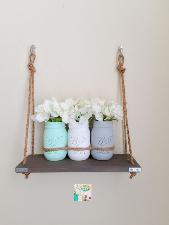 Mason Jars Wall Decor  Included: 2 hooks 3 distressed pint Mason Jars with twine Flowers Wood Shelf with rope  Mason Jars are hand painted and distressed. Oven cured and a matte clear coat to protect the paint. Wood plank stained in Briarsmoke. Protective coat added. 15L 5.5W   Contact me if you have any questions. Visit my store for other options available. Direct link www.butifuldesigns.etsy.com  USPS Shipping with tracking number and insurance.  Note: Clean jars with damp cloth. Do not…