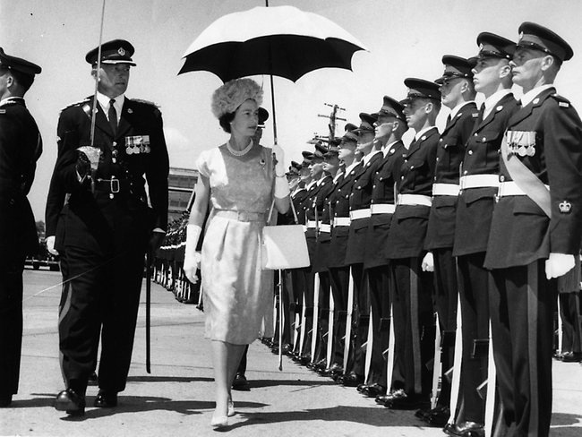 Queen in Brisbane | 6 March 1963: Queen Elizabeth II holding the parasol minutes after stepping shore from the Britannia onto Newstead Wharf. The Queen inspected her guard of honour from 3rd Battalion, Royal Australian Regiment
