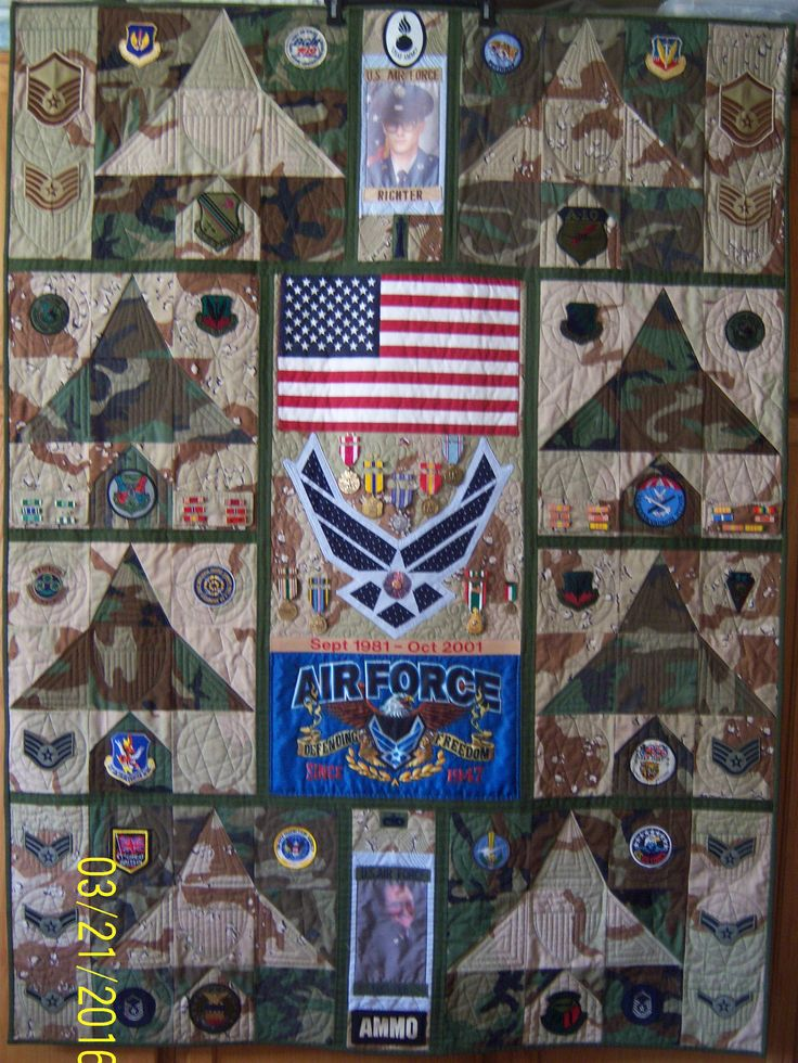 QUILT MADE FROM AIR FORCE UNIFORMS, PATCHES, MEDALS