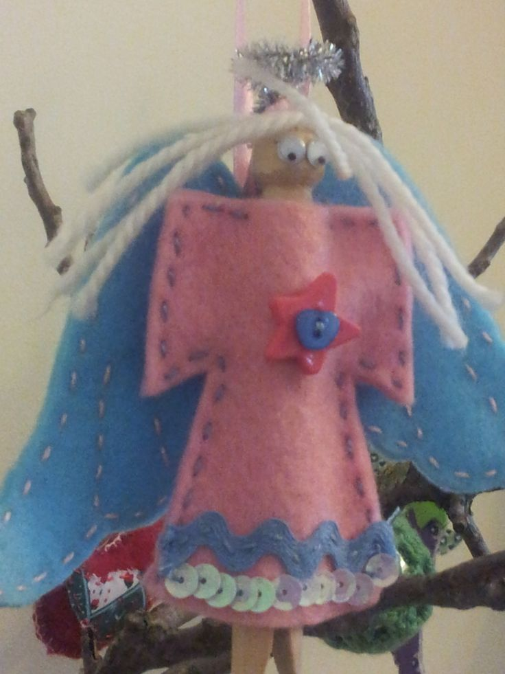 Our angel! Made from felt, wool, tinsel and an old fashioned clothes peg.
