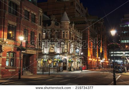 BIRMINGHAM, UK - SEPTEMBER 1, 2014: The building of Old Royal Pub an example of characteristic Victorian red brick and terracotta architecture in the center of the city at night. - stock photo
