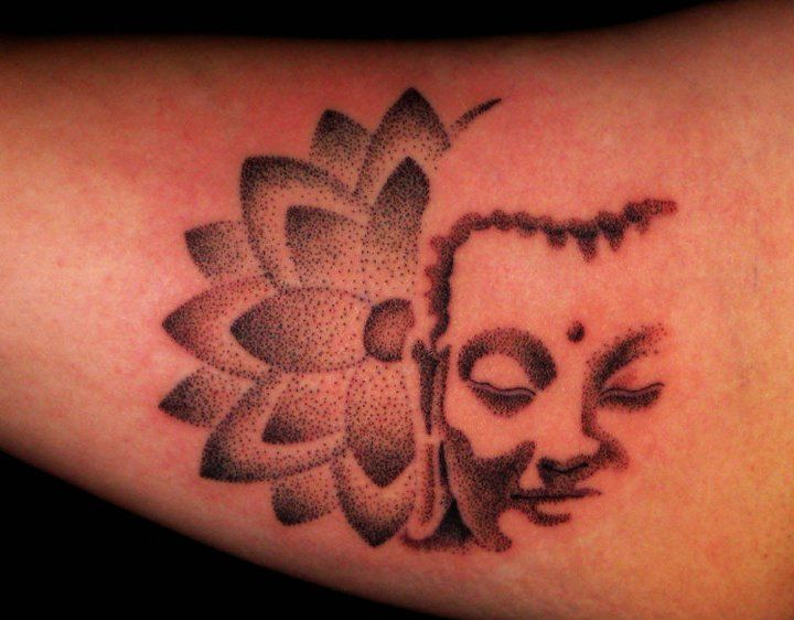 Love, love, love the beautiful and serene simplicity of this small Buddha/Lotus tattoo.... Tattoo done by: Jay Laviolette