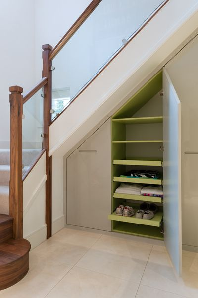 another simple yet pretty under stair space keep your clutter sorted by making use of underused space under the stairs or in the hallway of your home
