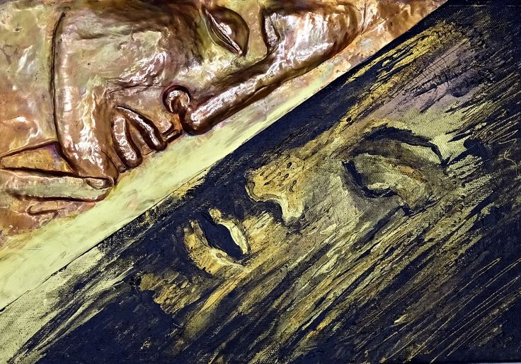 Face repoussed in a copper and added in acryl painting.
