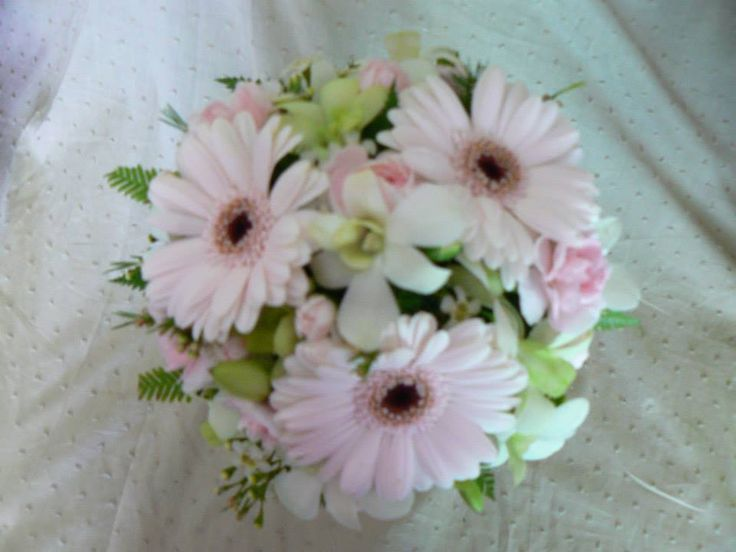 White orchids mixed with gerberas, spray carnations & Geraldton wax