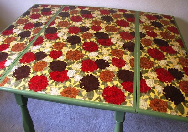 THIS IS AMAZING! I want to do this now!  Inspired Mod Podge decoupage table
