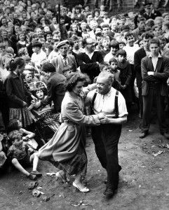 Glasgow: The Gorbals. Two of the crowd dancing during an open air concert in the Gorbals, 1959.