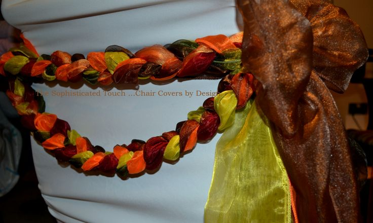 Autumnal organza plaited swag on white chair cover.   The Sophisticated Touch ...Chair Covers by Design