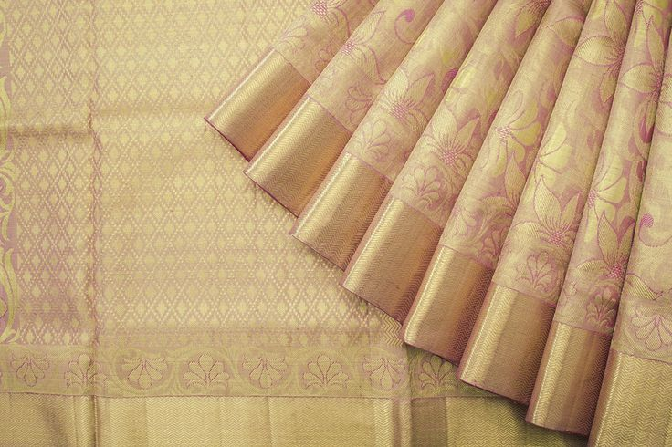 The vine design in onion pink and gold Kanjivaram is brimming with joyous aspirations.