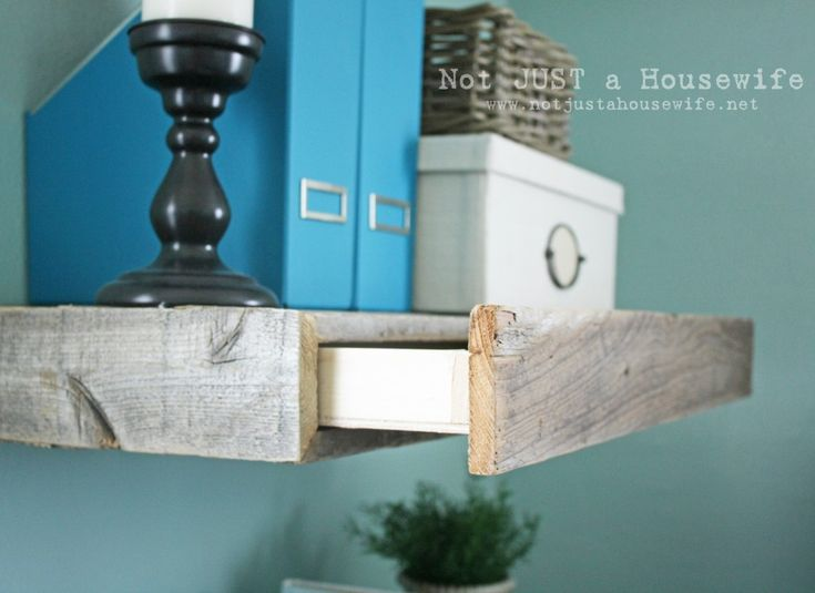 reclaimed wood floating shelves with secret drawers