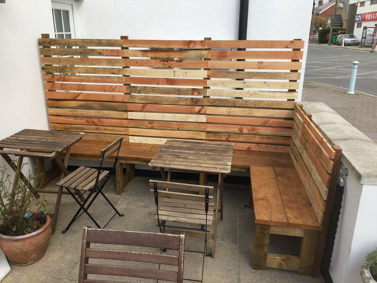 Outdoor benching made using reclaimed scaffold boards and pallet wood for The Paddle Cafe in Highcliffe, Dorset