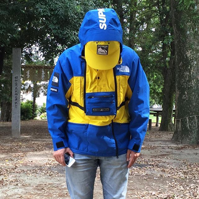 blue and yellow north face hoodie