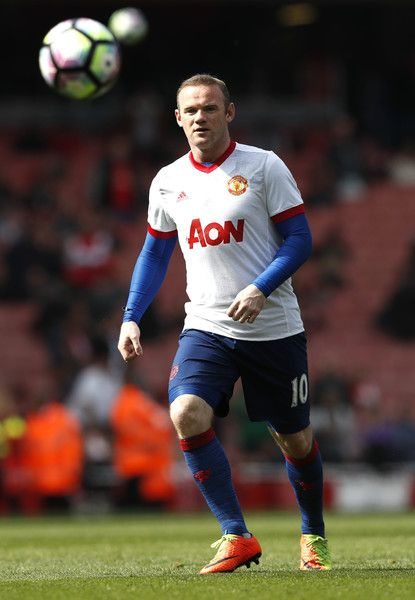 Manchester United's English striker Wayne Rooney warms up before the English Premier League football match between Arsenal and Manchester United at the Emirates Stadium in London on May 7, 2017.  / AFP PHOTO / Adrian DENNIS / RESTRICTED TO EDITORIAL USE. No use with unauthorized audio, video, data, fixture lists, club/league logos or 'live' services. Online in-match use limited to 75 images, no video emulation. No use in betting, games or single club/league/player publications.  /