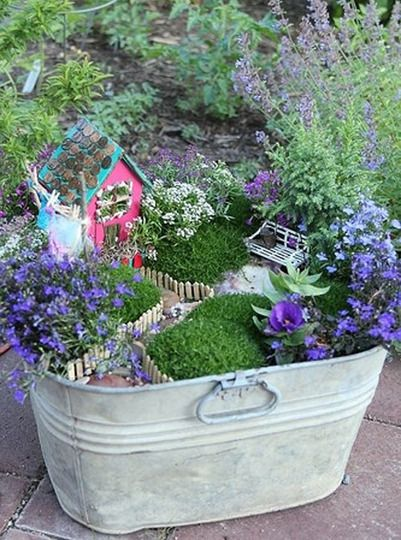 A great list of fairy garden tutorials/examples. MUST DO with the kids this summer!