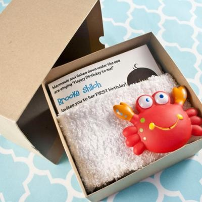 Super cute invite for beach party.  Invite wrapped in small white towel with a water squirt toy on top.