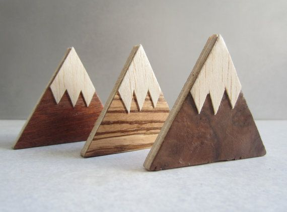 A set of 3 handmade wooden magnets. Plywood triangles covered in 3 different wood veneers, cut by hand (not by laser!) and varnished for protection.