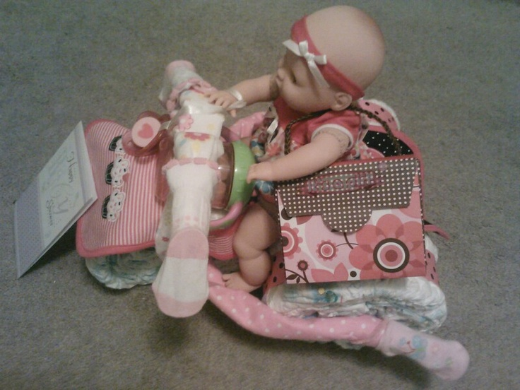Tricycle shaped diaper cake with doll