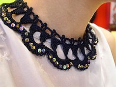 Ravelry: Black Lacy Triangles Necklace pattern by Fatima