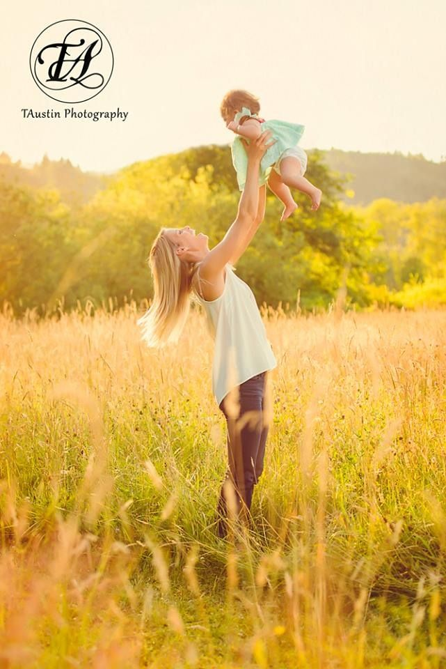 Photography session with a mother and 9 month old baby at sunset