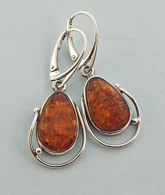 From Lithuania. A pair of genuine Baltic amber and sterling silver  earrings. AmberViktoria on Etsy.