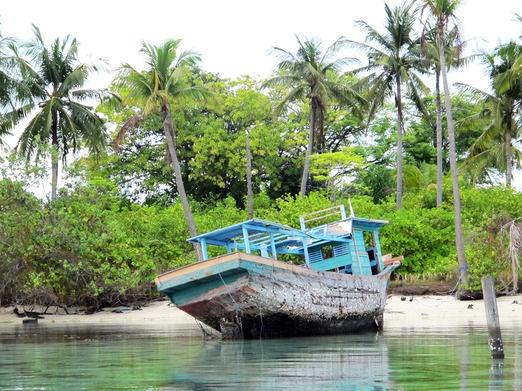 A beached boat on Pulau Menjangan Besar, opposite the main Karimunjawa Island.-- Photos by Peter Milne