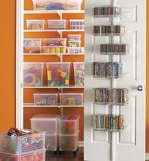 toy storage closet. easy! Using clear bins so that you can see what's inside is smart for toddlers. Paint color inside closet makes it look cute.